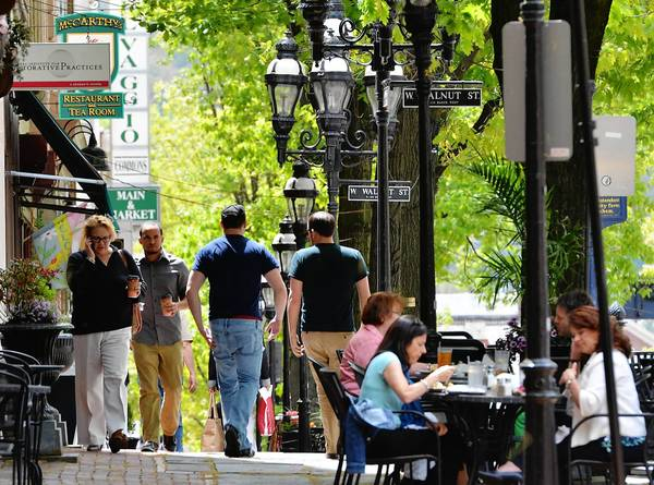 People walk, shop, and eat along Main Street in downtown Bethlehem during the lunch hour on Tuesday afternoon on May 7, 2013.