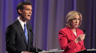 Los Angeles mayoral candidate Wendy Greuel's campaign organization has suspended her TV advertising two weeks before the election, a move that reflects her continuing struggle to raise enough money to compete head-to-head on the airwaves with her rival, Eric Garcetti.