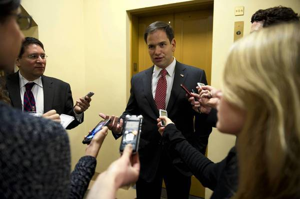 Sen. Marco Rubio (R-Fla.), who met with a group of conservatives about the immigration legislation, speaks to reporters about the bill Tuesday.