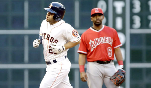 Jose Altuve rounds the bases after hitting a home run in his first at-bat against the Angels in the Astros' 7-6 victory Tuesday.