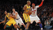NEW YORK -- Carmelo Anthony awoke from his shooting slumber to score 32 points and lead the New York Knicks to a 105-79 win over the Indiana Pacers in Game 2 of the Eastern Conference semifinals Tuesday at Madison Square Garden.