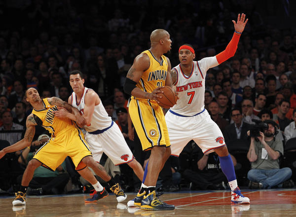 Carmelo Anthony #7 of the New York Knicks guards David West #21 of the Indiana Pacers during Game Two of the Eastern Conference Semifinals of the 2013 NBA Playoffs at Madison Square Garden on May 7, 2013 in New York City.