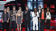 On 'The Voice,' from left: Justin Rivers, Holly Tucker, the Swon Brothers, Danielle Bradbery, Carson Daly, Kris Thomas, Garrett Gardner, Karina Iglesias and Sasha Allen.