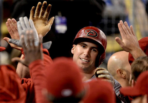 Arizona Diamondbacks' Paul Goldschmidt celebrates his go-ahead two-run home run in the dugout.