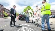 "SOUTH BEND - In advance of Bike to Work Week next week, Mayor Pete Buttigieg on Tuesday dedicated the city's first shared lane marking, or ""sharrow,"" on Colfax Avenue, west of Lafayette Boulevard downtown."
