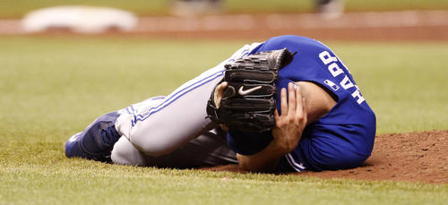 Blue Jays pitcher J.A. Happ was hit in the head by a line drive off the bat of the Rays' Desmond Jennings in the second inning Tuesday. (James Borchuck/Tampa Bay Times/MCT)