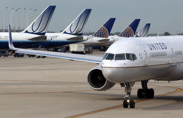 A United airplane taxis through Terminal 2 at O'Hare International Airport in Chicago.