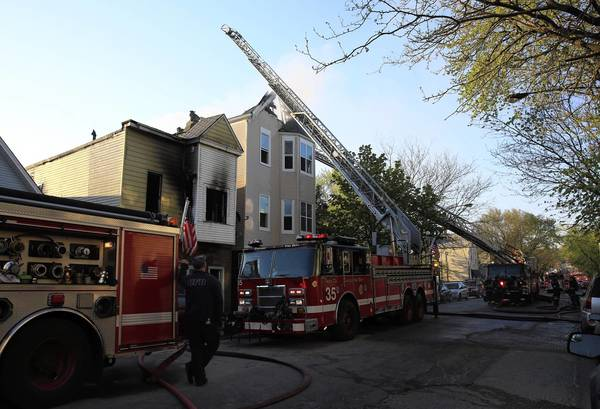 The Chicago Fire Department works to control a house fire that damaged two homes on the 1700 block of North Kimball Avenue in Chicago.