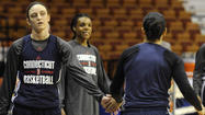 Although her days as the consummate UConn student-athlete are done, Kelly Faris still had some homework to do Tuesday at the Mohegan Sun Arena.