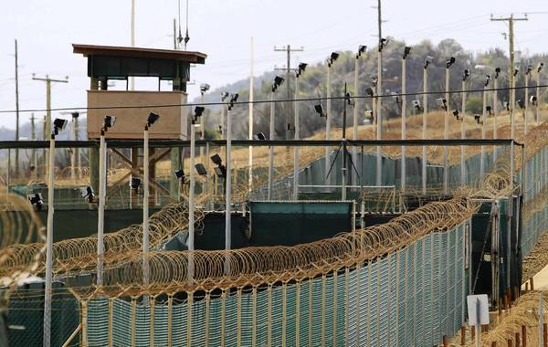 The exterior of Camp Delta is seen at the U.S. Naval Base at Guantanamo Bay in this file photo taken March 6, 2013. With his renewed vow to close the detention camp for foreign terrorism suspects at Guantanamo Bay, U.S. President Barack Obama has effectively assigned himself a list of possible ways to take the prison's population down from 166 to zero.