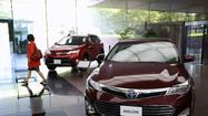 Toyota's quarterly profit more than doubled to 313.9 billion yen ($3.2 billion) as cost cuts and better sales worked with a weakening yen to add momentum to the automaker's comeback.