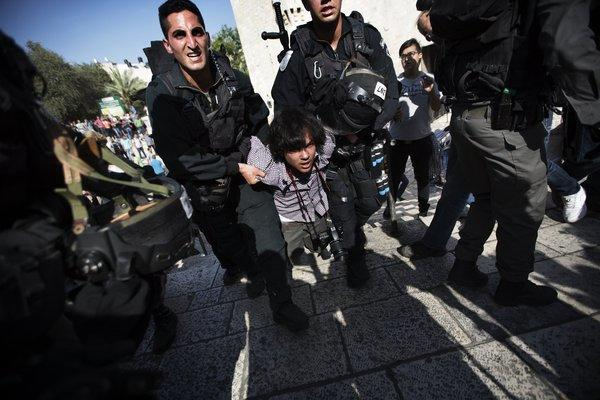 A young man is arrested by Israeli border police following a protest against Israelis celebrating Jerusalem Day on Wednesday at the Damascus Gate in Jerusalem's Old City.