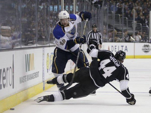 David Backes of St. Louis collides with Robyn Regehr of the Kings in Game 3.