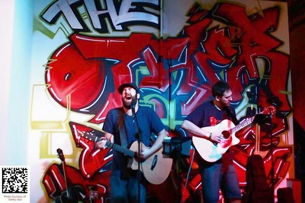 The Three Beards perform at The Other Side at the sober clubs grand opening held on April 27 . They say it is the first time they have ever been to or played in a sober bar. Band members described the atmosphere as laid back and the crowd as more respectful than those in typical bars.