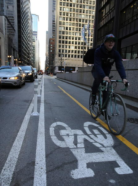 A bicyclist rides north along the bike path at Dearborn near Randolph streets in Chicago.