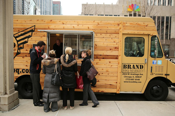 Customers buy lunch at the Brand BBQ Market truck in Chicago.