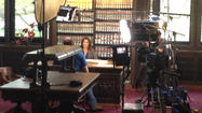 Supermodel Cindy Crawford was being filmed in the state library in Hartford on Wednesday morning for a documentary on genealogy. Library business proceeded uninterrupted during filming.