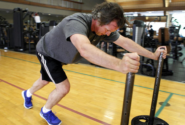 Glenn Gehan exercises during his twice-weekly, hour-long workout at Cooper Fitness Center in Dallas, Texas.