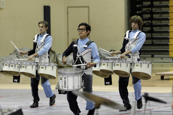 From left, William Huffman, Patrick Choto and Zac Adriance perform with the rest of the Edison High Drum Line.