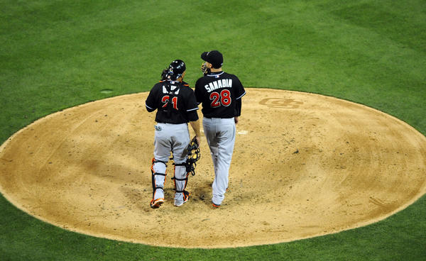 May 7, 2013; San Diego, CA, USA; Miami Marlins starting pitcher Alex Sanabia (28) talks with catcher Miguel Olivo (21) during the sixth inning against the San Diego Padres at Petco Park. Mandatory Credit: Christopher Hanewinckel-USA TODAY Sports ORG XMIT: USATSI-121278