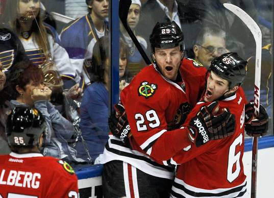 Bryan Bickell (center) and Andrew Shaw celebrate Bickell's goal during the second per