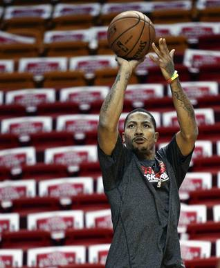 Derrick Rose warms up before Game 1.