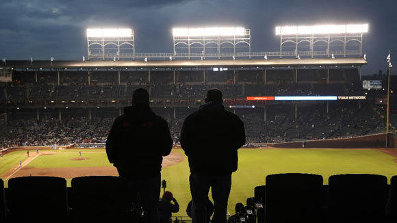 Fans watch the action in Wrigley Field from a rooftop at 3637 N. Sheffield Ave. in April.