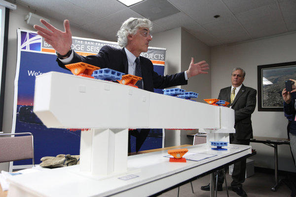 Bridge engineer Brian Maroney uses a model to explain the broken rod issue on the new span of the Bay Bridge.