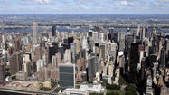 NEW YORK, May 8 (Reuters) - Two deals tosell two prime midtown Manhattan office buildings for more than $1 billion combined were reached on Wednesday - signaling another hike in New York City's commercial property values.