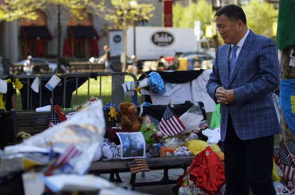 Amir Ismagulov, the father of Azamat Tazhayakov, who's charged with lying to authorities about purported bomber Dzhokhar Tsarnaev, visits the makeshift memorial for the victims of the Boston Marathon bombings on May 7.