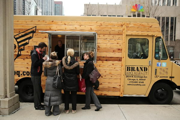 Bob Block, Giana Wilkinson, Kelly Zoet, and Leslie Venetz buy lunch at the Brand BBQ Market truck in Chicago.