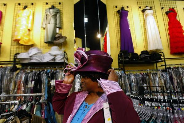 Ruby Smith tries on a hat at Divas, Ebby Tabarai's clothing store in downtown Los Angeles.
