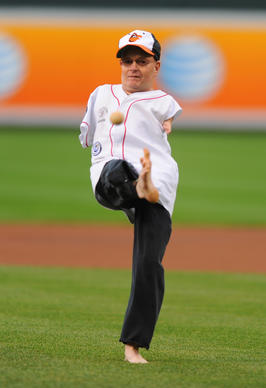 Tom Willis, who was born without arms, throws out the ceremonial first pitch with his foot to Orioles' T. J. McFarland at Oriole Park at Camden Yards on May 8, 2013.