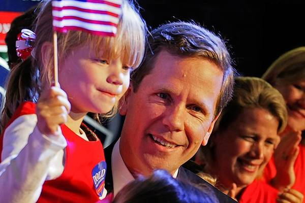Congressman Bob Dold Holds his daughter Honor, 5, as he leaves the stage following his concession speech in the race for the 10th District Congressional seat.