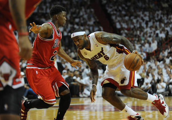 LeBron James of the Miami Heat dribes past the Chicago Bulls Jimmy Butler during the third quarter of the Eastern Conference semifinal game two, Wednesday May 6, 2013, at the AmericanAirlines Arena in Miami..Joe Cavaretta, SunSentinel (c)2013......