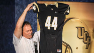 UCF unveiled its new football uniforms at its Hometown Huddle event this week. Like previous Knights jerseys during the Coach George O'Leary era, the new UCF uniforms don't include players' names on the back.