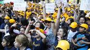 Thousands of people wearing bright yellow caps rallied in the Loop's Federal Plaza on Wednesday evening in support of privately run charter schools, which are under more scrutiny because of the city's plan to close 53 neighborhood schools.
