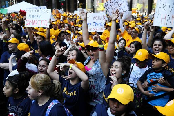 Thousands of students, parents and teachers participate in the Charter Parents United rally at Federal Plaza in Chicago on Wednesday. They were demanding equitable government funding for their students.