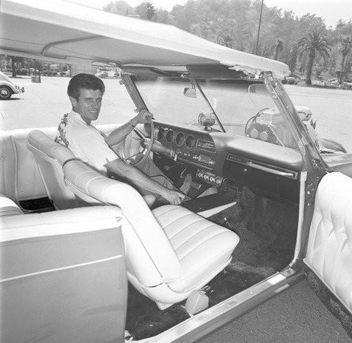 Dean Jeffries sits inside the 'Monkeemobile,' which he built.