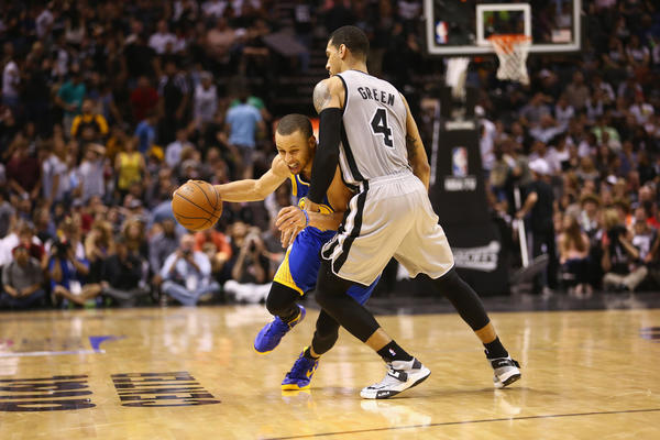 Stephen Curry #30 of the Golden State Warriors dribbles the ball against Danny Green #4 of the San Antonio Spurs during Game Two of the Western Conference Semifinals of the 2013 NBA Playoffs at AT&T Center on May 8, 2013 in San Antonio, Texas.