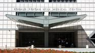 Ronald Reagan UCLA Medical Center improved slightly from an F to a D in a national hospital safety report released Wednesday, while Cedars-Sinai Medical Center stayed at a C grade.