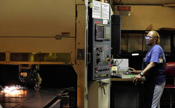 Diane Lewis operates a 2D/3D Laser cutting machine at Decimal Engineering.