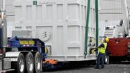 BRIDGEPORT — The fuel cell floated off the truck rig Wednesday morning, its massive weight aided by the skyward pull of a crane. Its delivery is the first of ten that will populate this city's new fuel cell park and deliver clean power to thousands of homes.