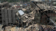 DHAKA, Bangladesh (AP) — A fire in an 11-story garment factory in Bangladesh killed eight people, including a ruling party politician and a top official in the country's powerful clothing manufacturers' trade group, as the death toll from the collapse of another garment factory building passed 900 on Thursday.