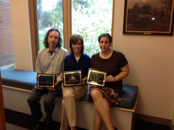 From left are Avon Free Public Library Director Glenn Grube along with librarians Patrice Celli and Tina Panik. They are showing awards given to the library and to Celli and Panik individually for a series of programs the library put on about the Civil War.