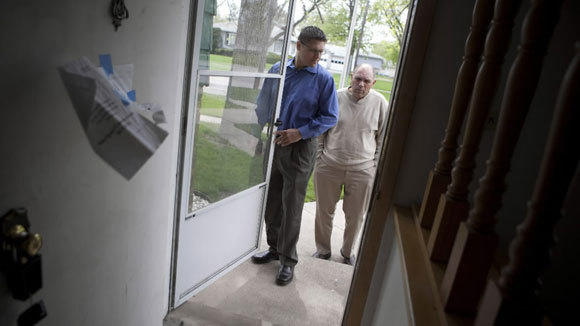 Representatives of Mack Cos. inspect a South Holland home in 2010.