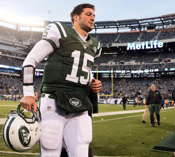 New York Jets quarterback Tim Tebow (15) runs off the field after the game against the San Diego Chargers at MetLife Stadium. Chargers won 27-17.