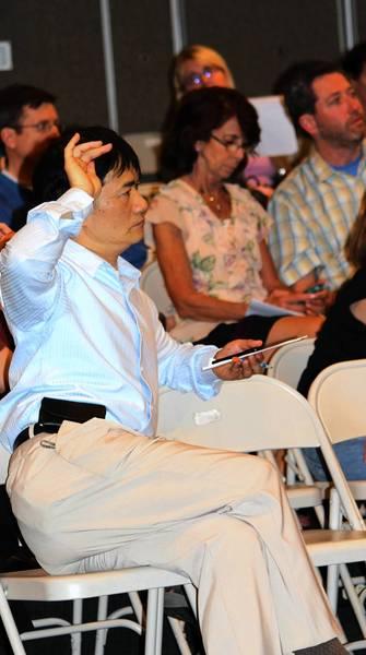 Parent Alex Qiu asks a question during a recent seminar.