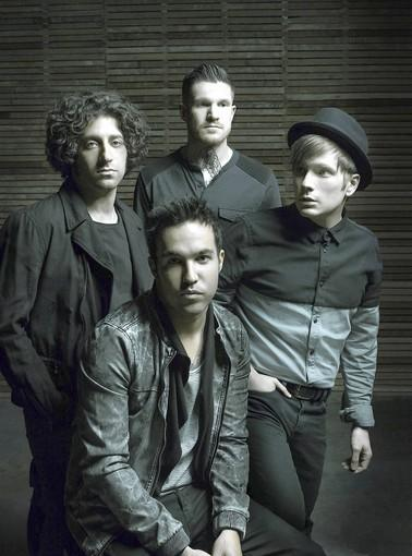 Fall Out Boy, clockwise (started with seated): Pete Wentz, Joe Trohman, Andy Hurley and Patrick Stump.