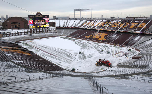 Workers remove snow from TCF Stadium before the Vikings' 2010 game there against the Bears.